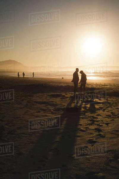 Spain, Galicia, Valdovino, Frouxeira beach at sunset Rights-managed stock photo