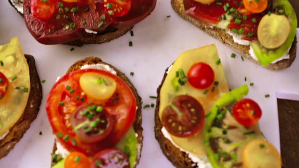 Tomato sandwich made with organic heirloom tomatoes. Royalty-free stock video