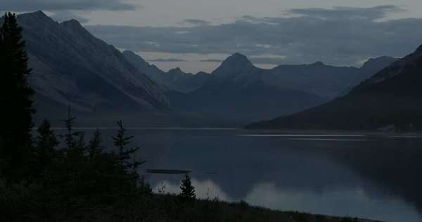 Wide shot of a landscape with a lake and mountains Royalty-free stock video