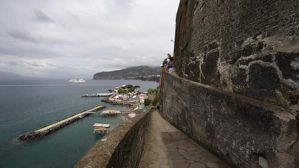 Wide shot of people ascending on the city wall of Sorrento, Italy Royalty-free stock video
