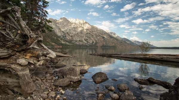 Timelapse at Jenny Lake with Kayaker paddling by in Grand Teton National Park, on a slider. Royalty-free stock video