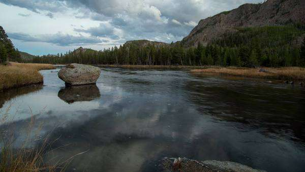 Evening timelapse over the Madison River in Yellowstone, as the clouds reflect in the river. Royalty-free stock video