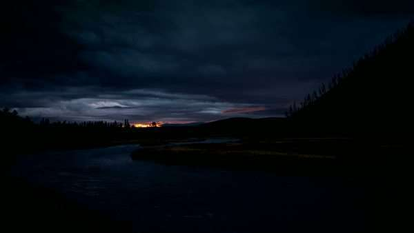 Timelapse of the Madison River in Yellowstone while the sun lights up the sky. Royalty-free stock video