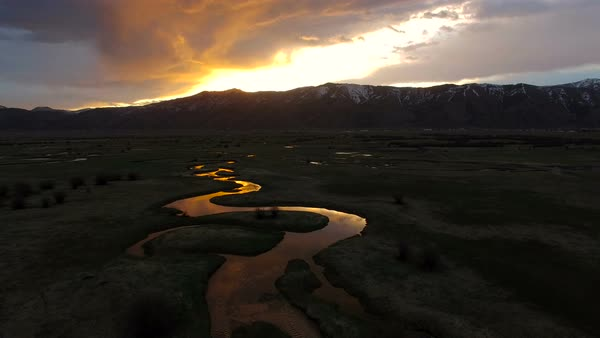 Flying over river as the sunrises in Wyoming. Royalty-free stock video