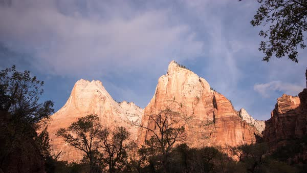 Time Lapse at Court of the Patriarchs in Zion National Park as red cliff walls lite up. Royalty-free stock video