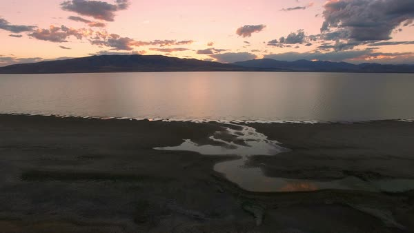 Flying over Utah Lake at dusk as the sky fades color Royalty-free stock video