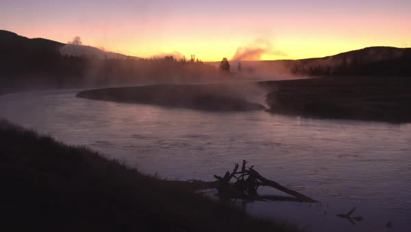 Steam rising from river flowing at sunrise in Wyoming. Royalty-free stock video