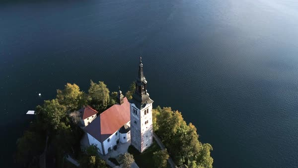 Aerial view of Lake Bled and Bled island showing old buildings including pilgrimage church Royalty-free stock video
