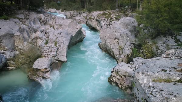 Soca River flowing through Great Soca Gorge in aerial view Royalty-free stock video