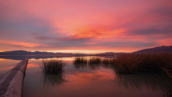 Sunset timelapse of pipe from Geneva going into Utah Lake Royalty-free stock video
