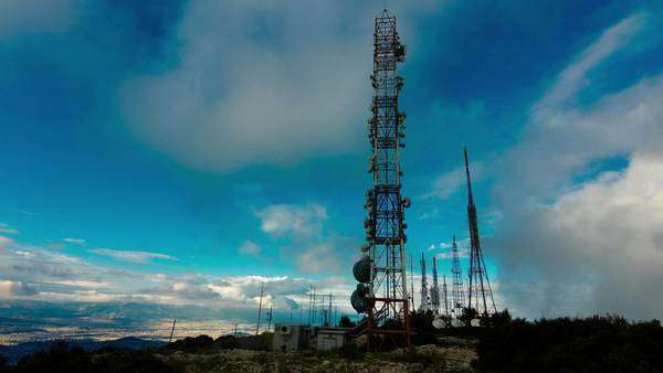 Timelapse of broadcast tower site at the top of a mountain with clouds passing by. Royalty-free stock video