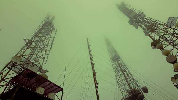 Wide angle timelapse of communication antenna towers in mountain fog. Royalty-free stock video