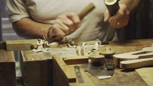 Old retired wood carver practicing his craft in his workshop, tracking/slider. Royalty-free stock video