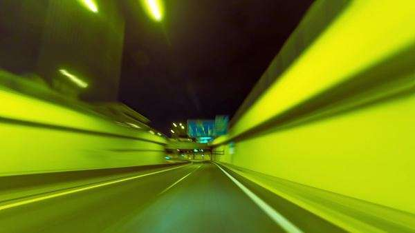 Ultra wide angle (8mm) pov night driving hyperlapse on a modern highway passing a series of tunnels. Royalty-free stock video
