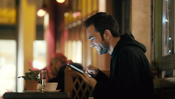 Young man browsing with tablet outside at winter at night. Royalty-free stock video