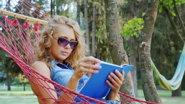 Young woman lying in a hammock Royalty-free stock video