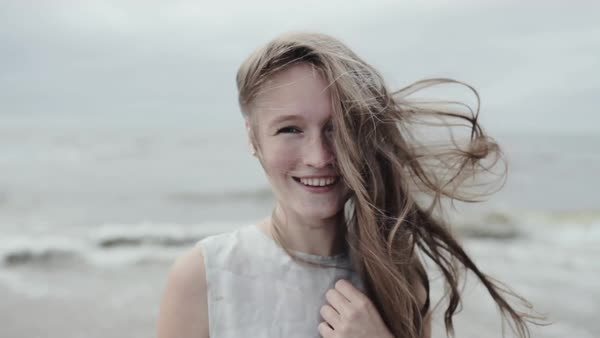 Medium close-up shot of a young woman on a beach Royalty-free stock video