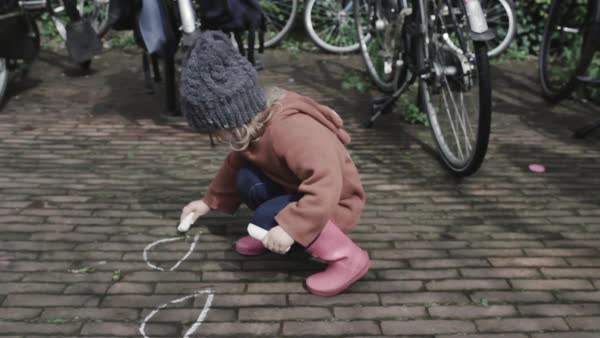 Medium shot of a little girl drawing with chalks Royalty-free stock video