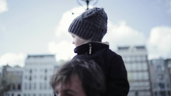 Medium close-up shot of a little girl sitting on the shoulders of her father Royalty-free stock video