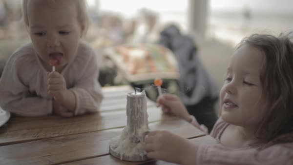 Hand-held shot of a toddler blowing out a candle Royalty-free stock video