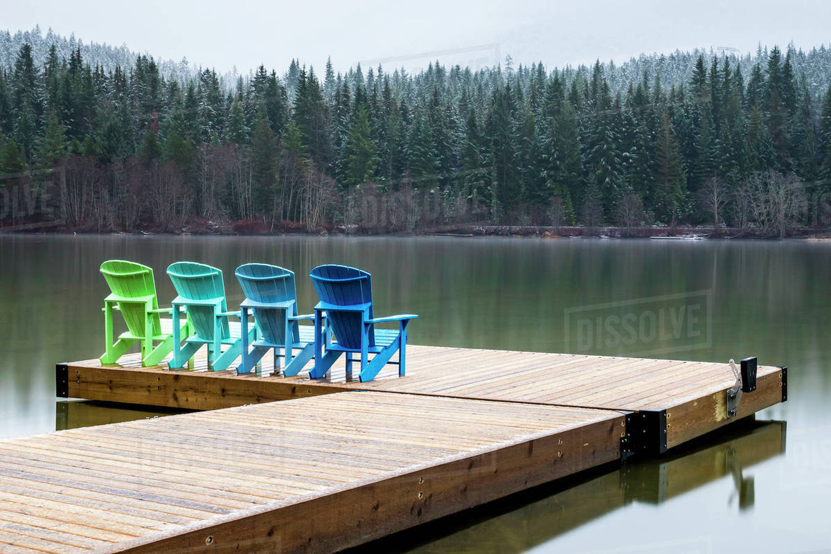 Four Adirondack Chairs Sit On A Dock On Green Lake D1129_12_567