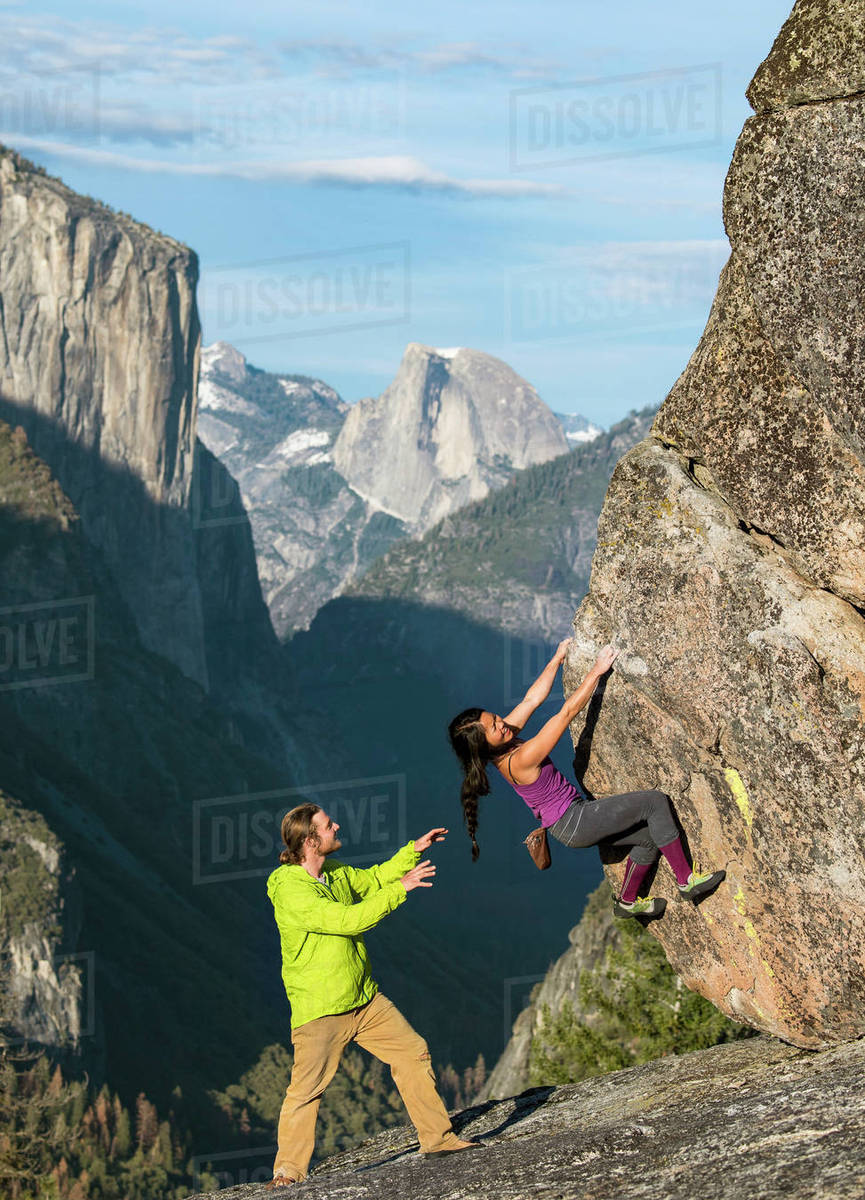 climbers in yosemite with half dome and el capitan in background