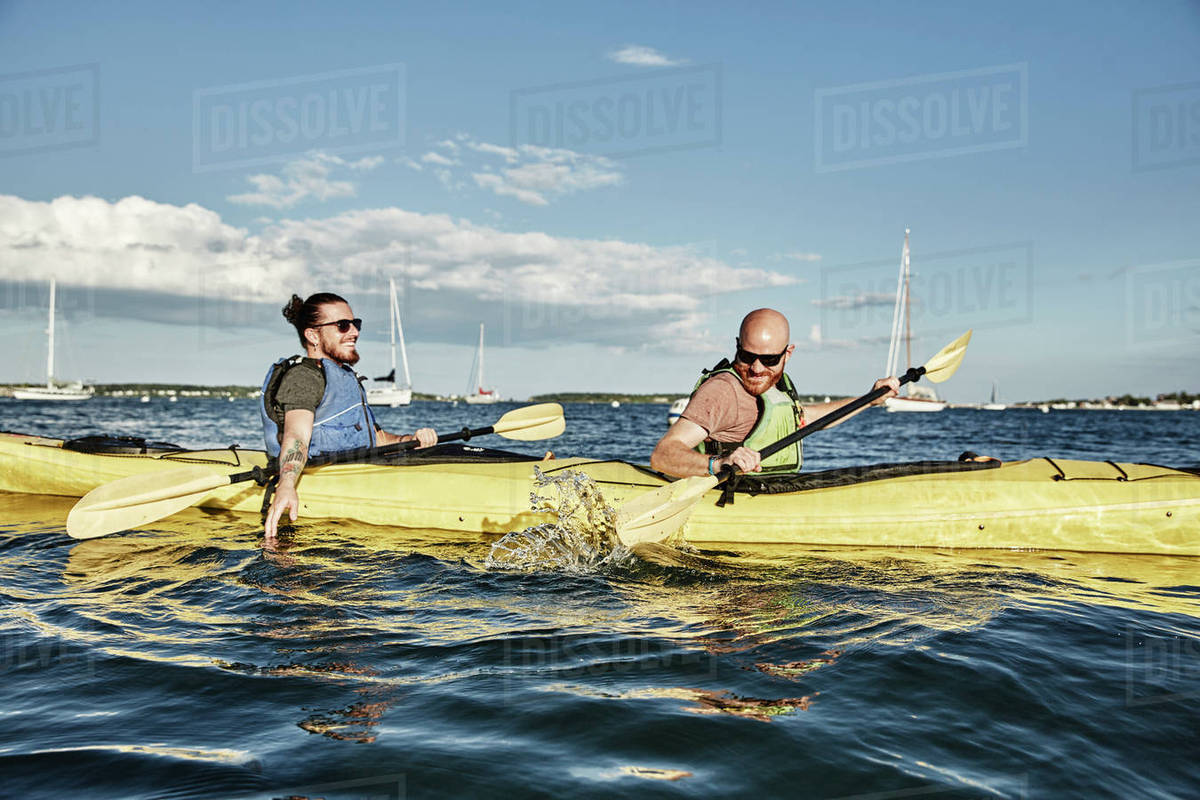 photograph of two men in tandem sea kayak portland maine usa