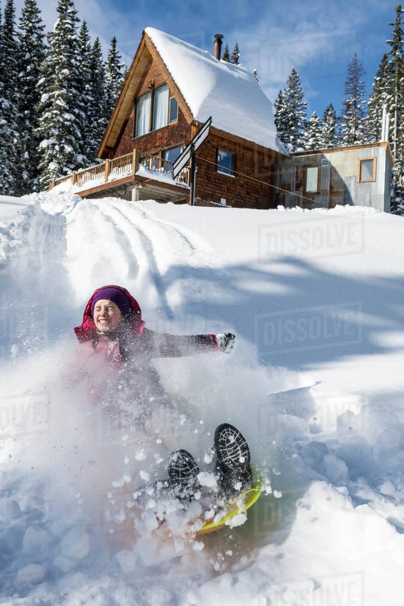 Young Girl Sledding In Powder Snow Below Mountain Cabin Near Molas Pass Silverton Colorado Usa Stock Photo Dissolve