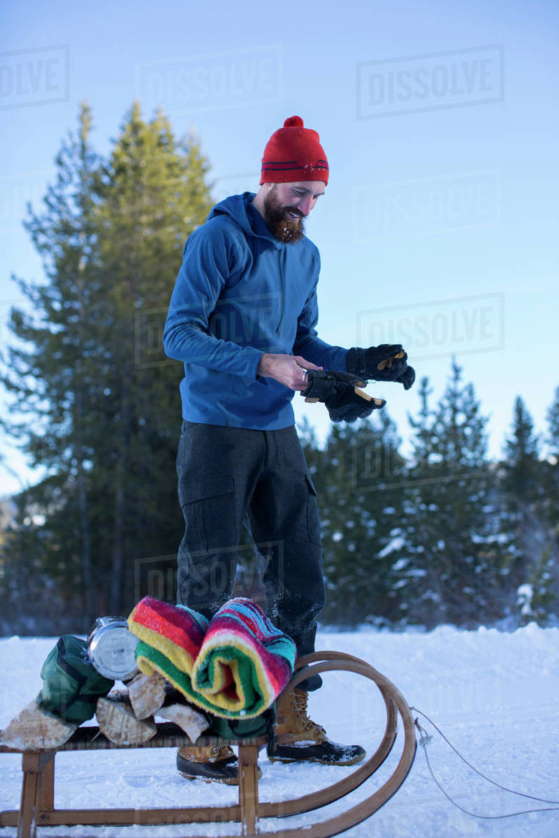 Adult man preparing to pull sled with winter camping ...