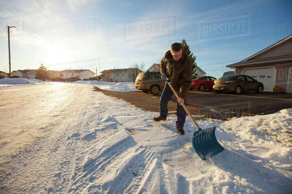 A man Shovels snow in northern Alberta. Royalty-free stock photo