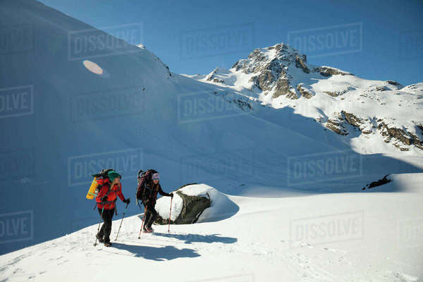Two active female backpackers hiking below Joffre Peak. Royalty-free stock photo