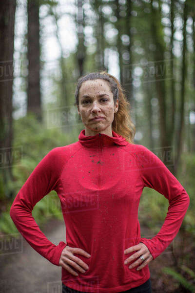 Portrait Of A Female Trail Runner With Mud On Her Face In Forest Park, Portland Royalty-free stock photo