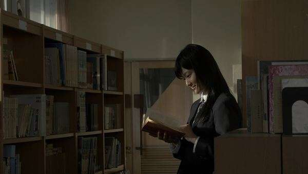 High-school student with book in the school library Royalty-free stock video