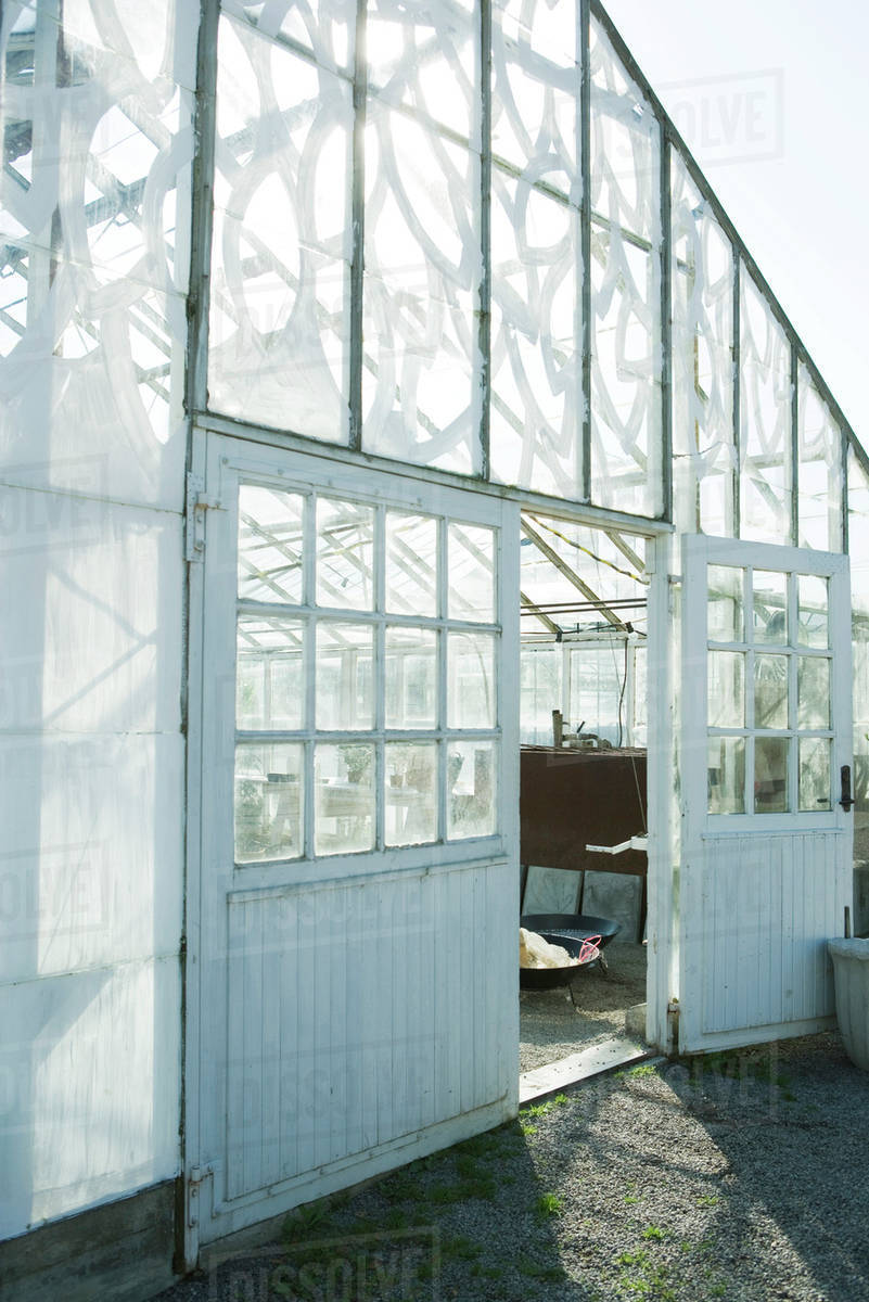 Greenhouse door propped open & Greenhouse door propped open - Stock Photo - Dissolve