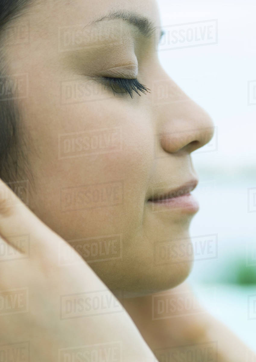 Woman With Hands Against Side Of Face Eyes Closed Profile Extreme Close Up Stock Photo