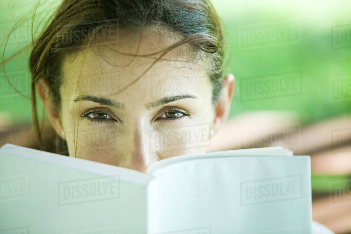 Woman looking over book Royalty-free stock photo