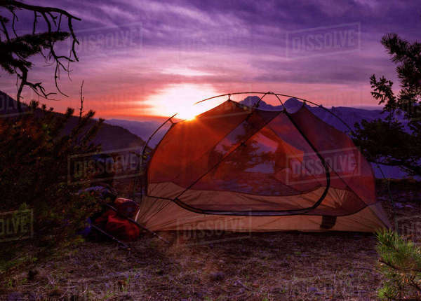 Camping tent against backdrop of sunset in Banff National Park. Royalty-free stock photo