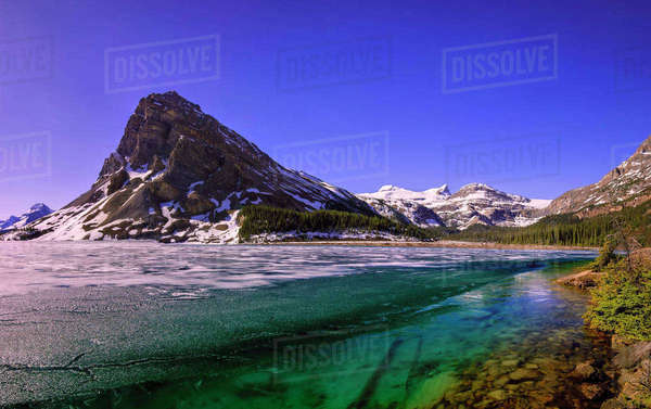 Mountain against blue sky in Bow Lake, Banff National Park Royalty-free stock photo