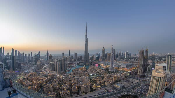 Dubai Downtown day to night transition timelapse with Burj Khalifa and other towers panoramic view from the top before new year celebration in Dubai, United Arab Emirates. Lights turning on. Fisheye lens Royalty-free stock video