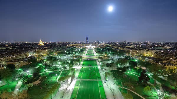 Champs de Mars from the Eiffel tower at night with rising Moon timelapse and a love heat in the grass, Paris, France Royalty-free stock video