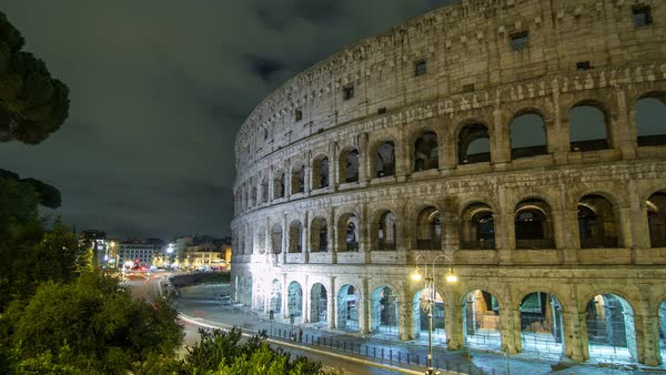 View of Colosseum illuminated at night timelapse hyperlapse in Rome, Italy Royalty-free stock video