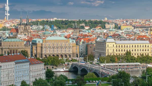Beautiful View On Prague In Czech Republic timelapse With Flowing River Vltava, manes bridge, Church of our lady before Tyn And With Zizkov Television Tower In Background. View from above near Prague castle Royalty-free stock video