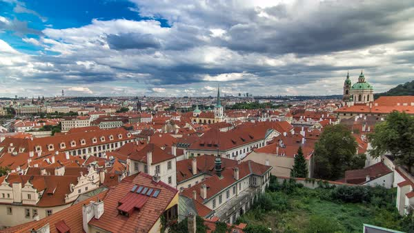 Panorama of Prague Old Town with red roofs timelapse, famous Charles bridge and Vltava river, Czech Republic. View from above near Prague castle Royalty-free stock video