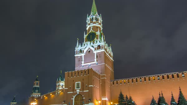 View of The Saviour (Spasskaya) Tower timelapse hyperlapse and Kremlin walls of Moscow Kremlin, Russia at night in winter. View from Red Square Royalty-free stock video