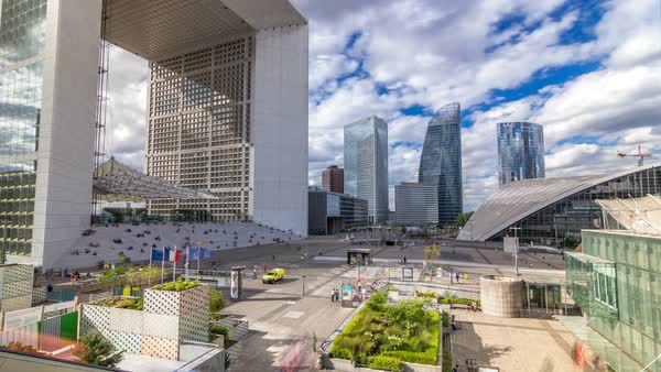 The Grande Arche and modern skyscrapers timelapse hyperlapse in the Defense business district of Paris, France. Blue cloudy sky at summer day. Top view Royalty-free stock video