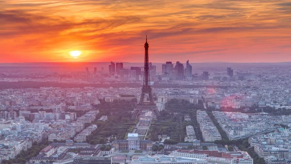 Panorama of Paris at sunset timelapse. Eiffel Tower view from observation deck of montparnasse building in Paris - France. Colorful sky at summer day Royalty-free stock video