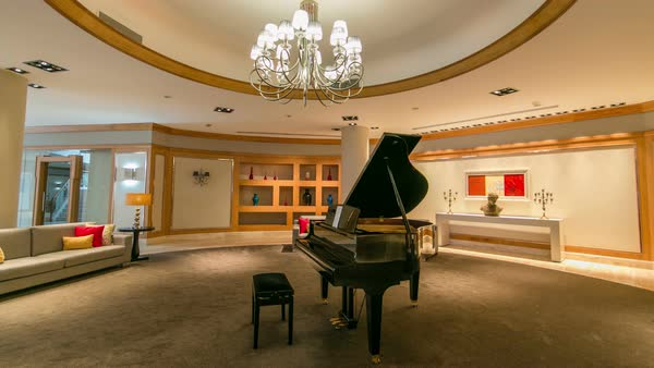 Grand piano in a luxury interior timelapse hyperlapse with sofa and chandelier Royalty-free stock video