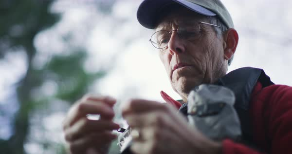 Low-angle shot of a man tying a fishing knot Royalty-free stock video