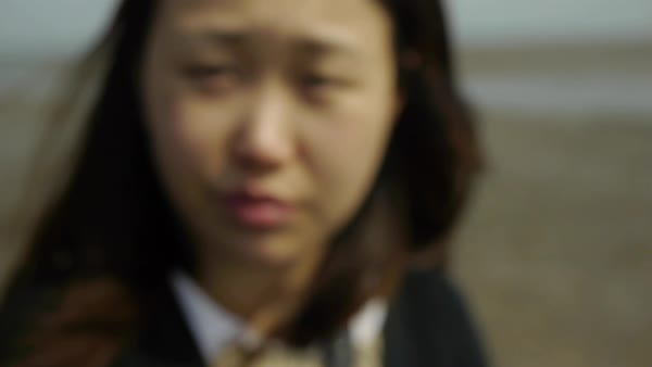Hand-held headshot of young Asian woman in Korea Royalty-free stock video