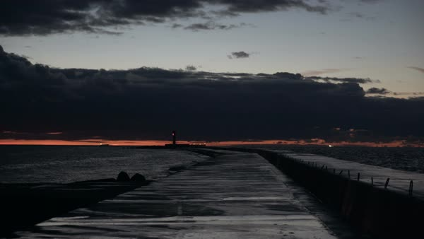 Jetty with a lighthouse late after sunset Royalty-free stock video